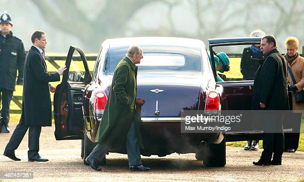 Prince Philip Duke of Edinburgh and Queen Elizabeth II arrive at St Mary Magdalene Church Sandringham to attend Sunday service on January 12 2014...