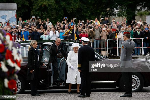 Prince Philip Duke of Edinburgh and Queen Elizabeth II arrive for a wreath laying ceremony at the Neue Wache on the second day of a four day state...