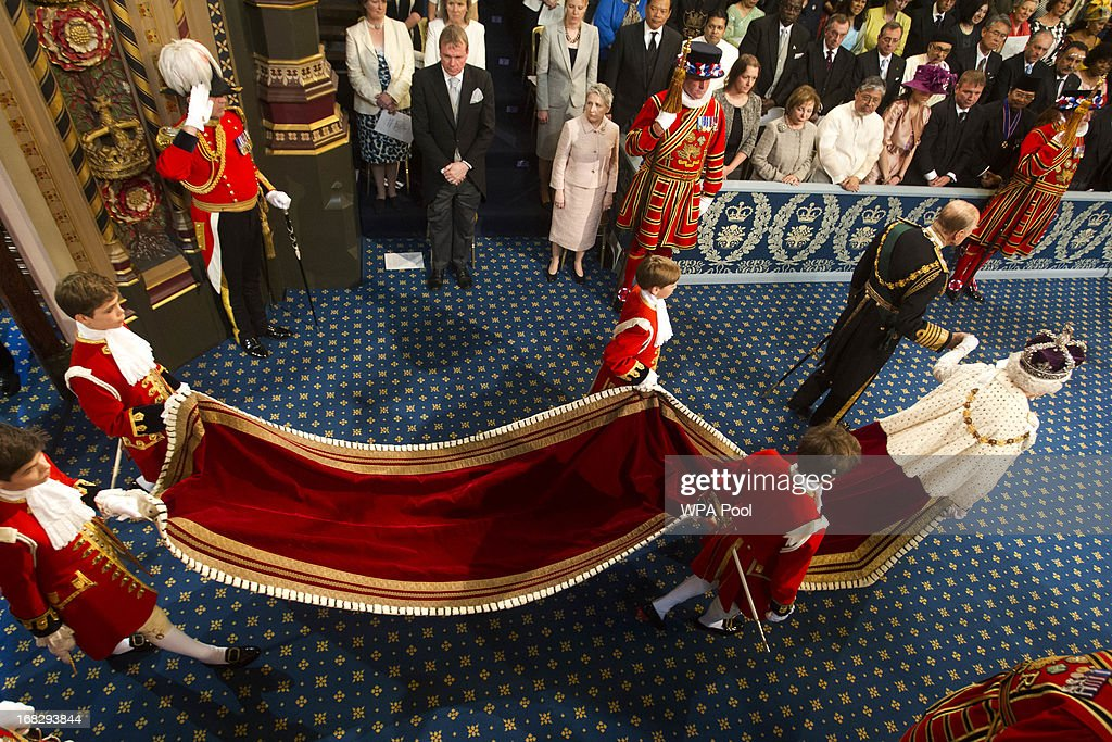 Prince Philip, Duke of Edinburgh and Queen Elizabeth II arrive for the state opening of Parliament at the House of Lords on May 8, 2013 in London, England. Queen Elizabeth II will unveil the coalition government's legislative programme in a speech delivered to Members of Parliament and Peers in The House of Lords. Proposed legislation is expected to be introduced on toughening immigration regulations, capping social care costs in England and setting a single state pension rate of 144 GBP per week.