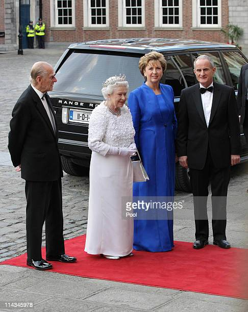 Prince Philip, Duke of Edinburgh and Queen Elizabeth II arrive with Irish President Mary McAleese and her husband Dr. Martin McAleese for a State...