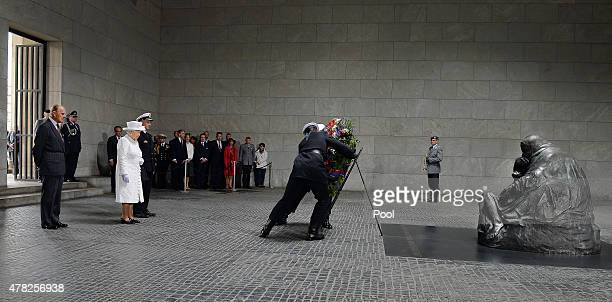 Prince Philip Duke of Edinburgh and Queen Elizabeth II during a wreath laying ceremony at the Neue Wache on the second day of a four day state visit...