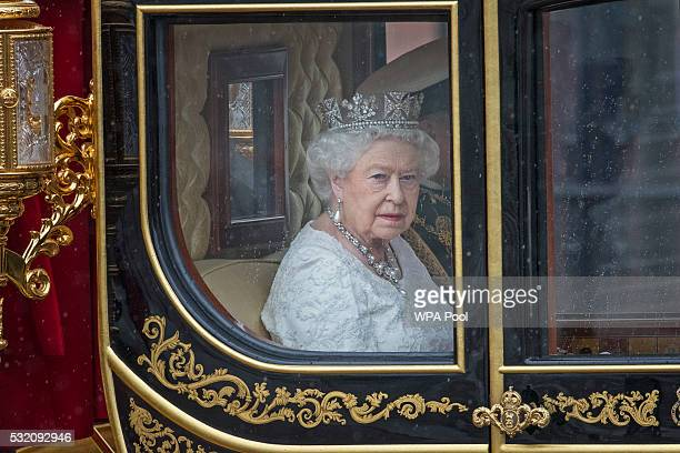 Prince Philip Duke of Edinburgh and Queen Elizabeth II on their way to the Houses of Parliament sit in the Jubilee State Carriage before she...