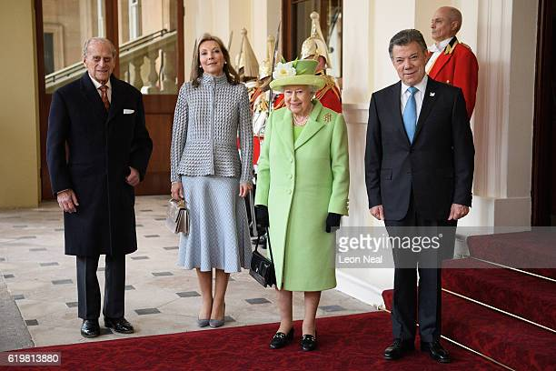 Prince Philip, Duke of Edinburgh and Queen Elizabeth II pose for a group photograph with Colombia's President Juan Manuel Santos and his wife Maria...