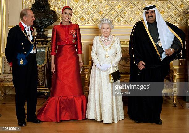 Prince Philip Duke of Edinburgh and Queen Elizabeth II pose with Qatar's Emir Sheikh Hamad bin Khalifa al Than and his wife Sheikha Mozah bint Nasser...