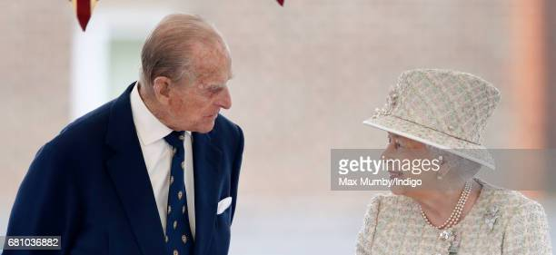 Prince Philip Duke of Edinburgh and Queen Elizabeth II watch a parade as they visit Pangbourne College to celebrate it's centenary on May 9 2017 in...