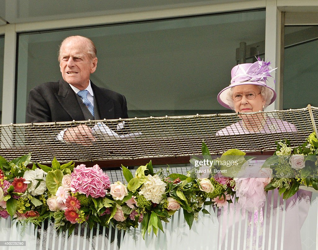 Prince Philip, Duke of Edinburgh, and Queen Elizabeth II watch The Investec Derby during Derby Day at the Investec Derby Festival at Epsom Downs Racecourse on June 6, 2014 in Epsom, England.