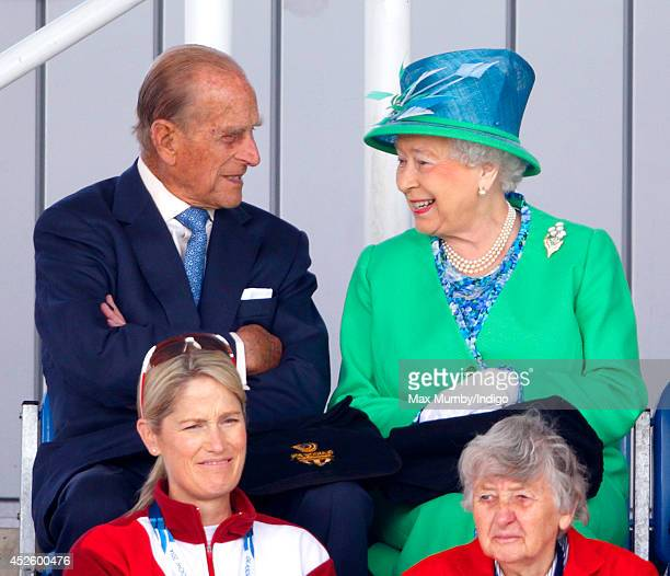 Prince Philip, Duke of Edinburgh and Queen Elizabeth II watch the England vs Wales women's hockey match at the Glasgow National Hockey Centre on day...