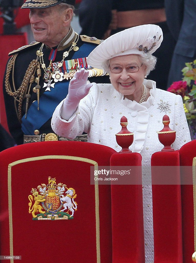 Prince Philip, Duke of Edinburgh and Queen Elizabeth II waves from the Spirit of Chartwell during the Diamond Jubilee Thames River Pageant on June 3, 2012 in London, England. For only the second time in its history the UK celebrates the Diamond Jubilee of a monarch. Her Majesty Queen Elizabeth II celebrates the 60th anniversary of her ascension to the throne. Thousands of well-wishers from around the world have flocked to London to witness the spectacle of the weekend's celebrations. The Queen along with all members of the royal family will participate in a River Pageant with a flotilla of a 1,000 boats accompanying them down the Thames.