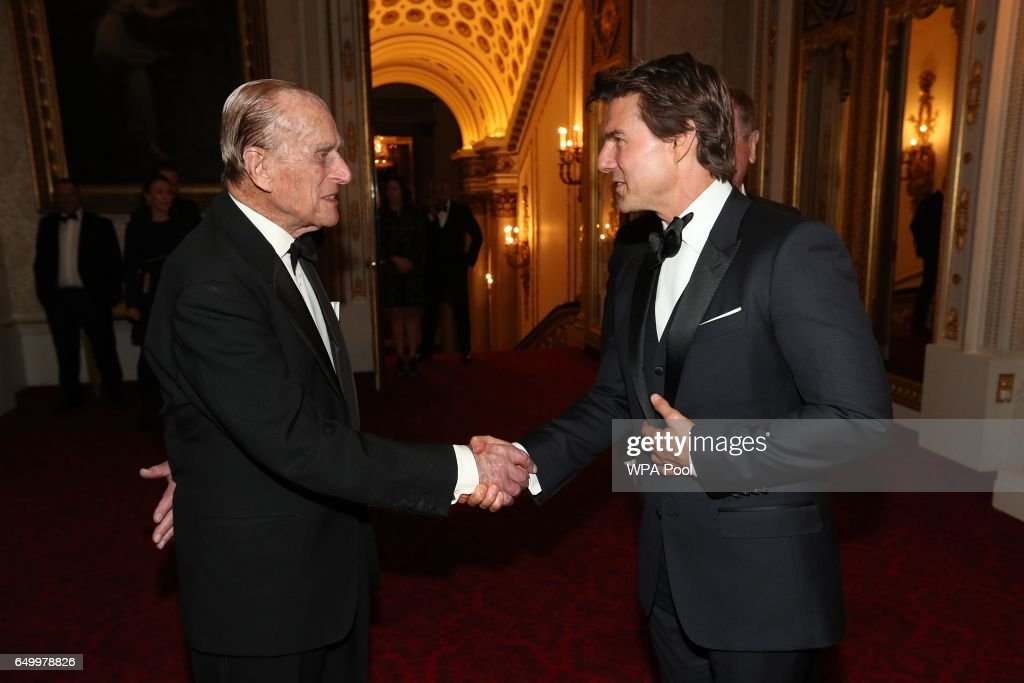 Prince Philip, Duke of Edinburgh and Tom Cruise meet during a dinner to mark the 75th anniversary of the Outward Bound Trust at Buckingham Palace on March 8, 2017 in London, England.