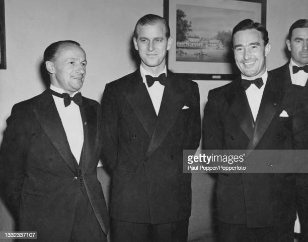 Prince Philip, Duke of Edinburgh attends a cricket writers club dinner with Australian cricketer Don Bradman , on left, and English cricketer Denis...
