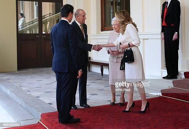 Prince Philip Duke of Edinburgh bids farewell to Mexico's First Lady Angelica Rivera as Queen Elizabeth II and Mexican President Enrique Pena Nieto...