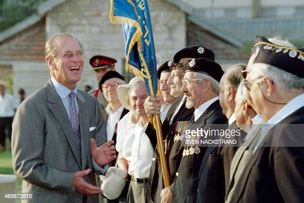 Prince Philip Duke of Edinburgh bursts out in laughter during a conversation with WW II veterans after a wreathlaying ceremony at the main...