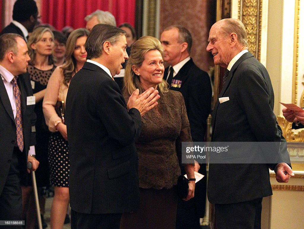 Prince Philip, Duke Of Edinburgh (R) chats to David Ruffley, MP for Bury St Edmunds (3rd R) during a reception for MPs and MEPs at Buckingham Palace on March 5, 2013 in London, England. The reception was attended by Prince Philip, Duke Of Edinburgh and Sophie, Countess of Wessex.
