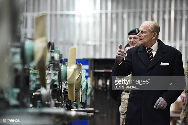 Prince Philip, Duke of Edinburgh , Colonel-in-Chief, Royal Electrical and Mechanical Engineers , looks at Land Rover engines in a hangar during a...