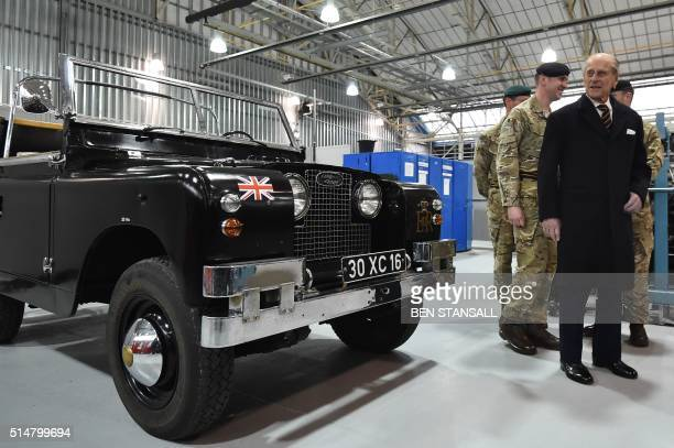 Prince Philip, Duke of Edinburgh , Colonel-in-Chief, Royal Electrical and Mechanical Engineers , looks at a Black 1960s ceremonial Land Rover Series...