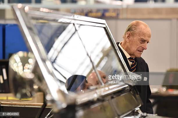 Prince Philip, Duke of Edinburgh, Colonel-in-Chief, Royal Electrical and Mechanical Engineers , looks at a Black 1960s ceremonial Land Rover Series...