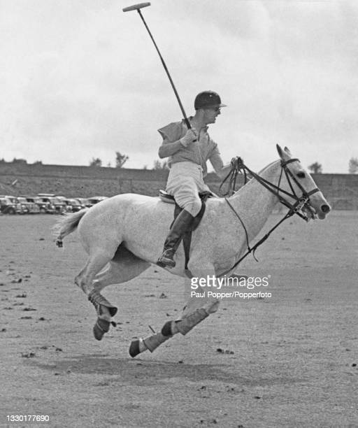 Prince Philip, Duke of Edinburgh competes on horseback for the Cowdray Park team against Beechwood in the semi-finals of the Tyro Cup polo tournament...