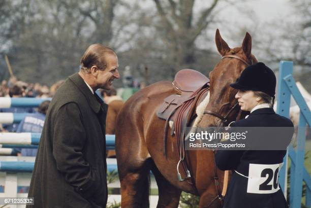 Prince Philip, Duke of Edinburgh congratulates his daughter Princess Anne after she and her horse 'Doublet' competed to finish in 5th place at the...