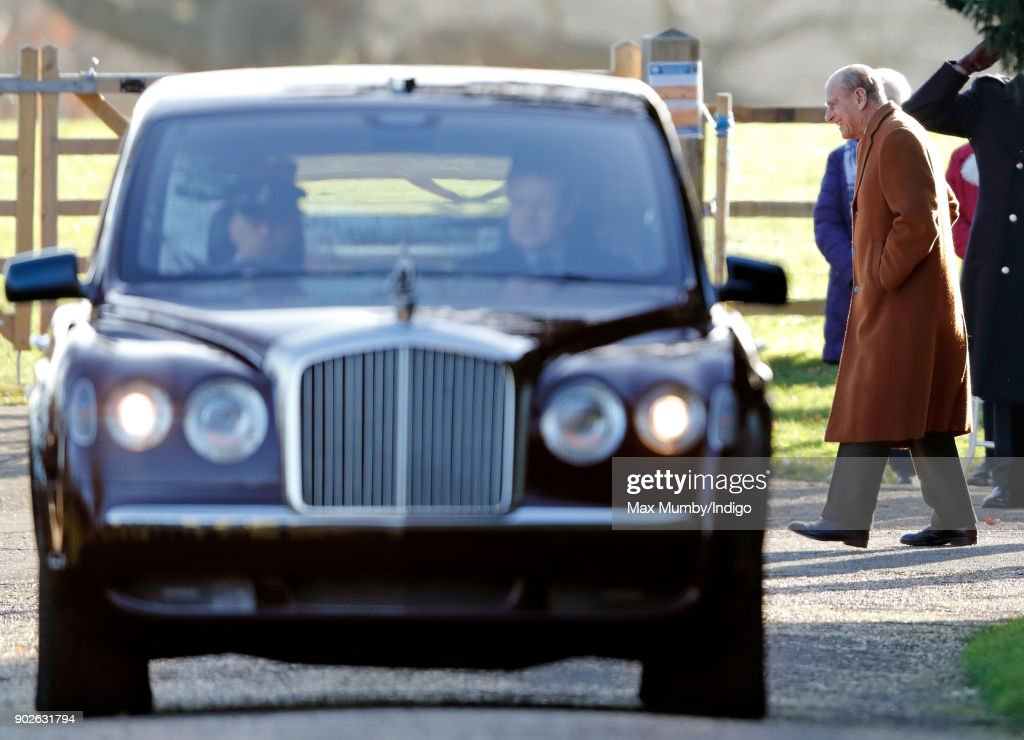 Prince Philip, Duke of Edinburgh departs on foot as Queen Elizabeth II is driven by car after attending Sunday service at St Mary Magdalene Church, Sandringham on January 7, 2018 in King's Lynn, England.