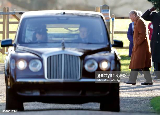 Prince Philip Duke of Edinburgh departs on foot as Queen Elizabeth II is driven by car after attending Sunday service at St Mary Magdalene Church...