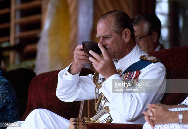 Prince Philip Duke of Edinburgh drinks whales teeth kava while watching traditional dancing on October 30 1982 in Suva Fiji Queen Elizabeth II And...
