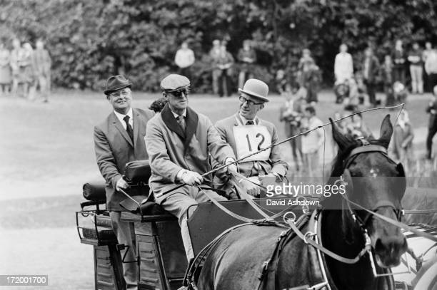 Prince Philip Duke of Edinburgh drives a team of bays owned by Queen Elizabeth II whilst competing in the Marathon event at the Royal Windsor Horse...