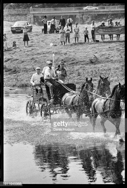 Prince Philip, Duke of Edinburgh drives a team of four horses during a carriage driving event in Penrith, England, 1975.