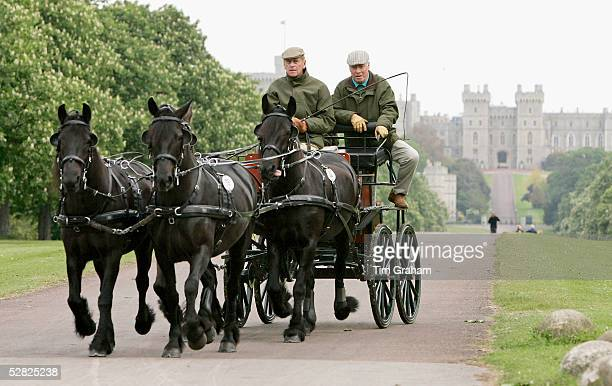 Prince Philip, Duke of Edinburgh drives along The Long Walk to compete with a team of fell ponies in the carriage driving competition at the Royal...