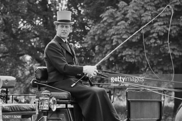 Prince Philip, Duke of Edinburgh, driving a carriage, UK, 28th May 1975.