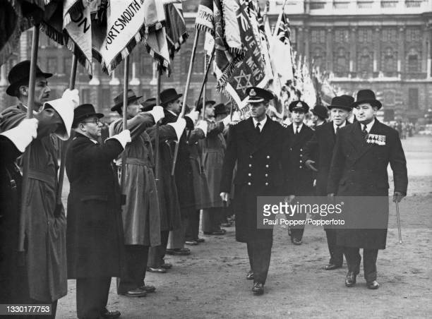 Prince Philip, Duke of Edinburgh , escorted by Commander F Ash Lincoln , inspects the standard bearers during a parade of Jewish ex-servicemen taking...