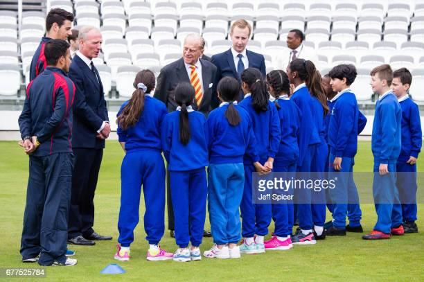 Prince Philip Duke of Edinburgh escorted by Matthew Fleming President of Marylebone Cricket Club meets pupils from St Edward's Catholic Primary...