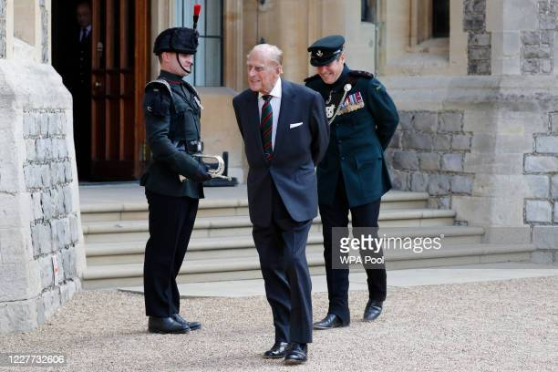 Prince Philip , Duke of Edinburgh flanked by Assistant Colonel Commandant, Major General Tom Copinger-Symeas inspects buglers during the transfer of...