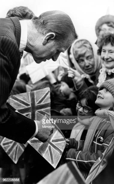 Prince Philip Duke of Edinburgh gives some Royal advice to Joanne Miller whose Union Jack flag was upside down during his visit to Liverpool 8th...