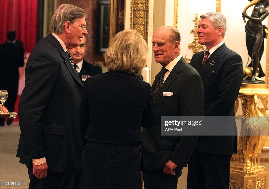 Prince Philip, Duke Of Edinburgh (2nd R) greets Bill Cash, MP for Stone (L) during a reception for MPs and MEPs at Buckingham Palace on March 5, 2013 in London, England. The reception was attended by Prince Philip, Duke Of Edinburgh and Sophie, Countess of Wessex.