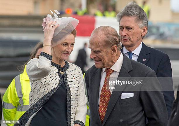 Prince Philip Duke of Edinburgh greets Susan Hammond and British Foreign Secretary Philip Hammond as he arrives for the Commonwealth Heads of State...