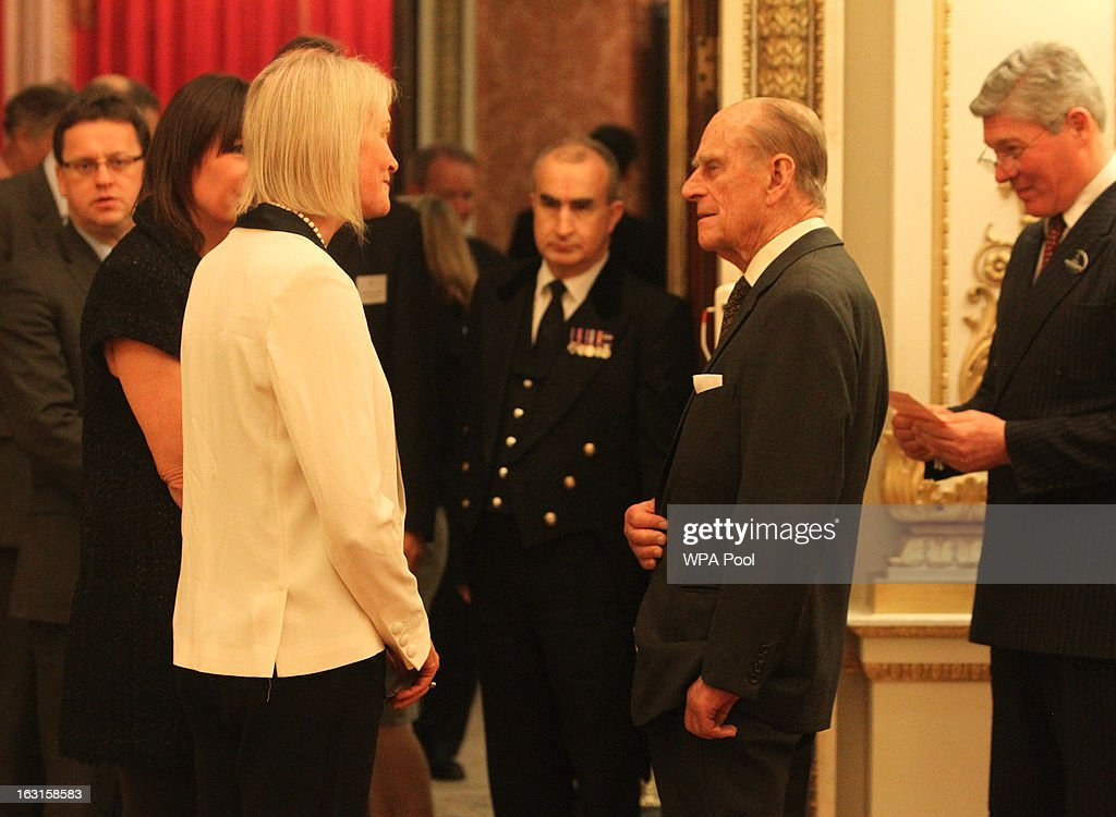 Prince Philip, Duke Of Edinburgh (centre R) greets Vice Chairman of the Conservative Party Margo James MP during a reception for MPs and MEPs at Buckingham Palace on March 5, 2013 in London, England. The reception was attended by Prince Philip, Duke Of Edinburgh and Sophie, Countess of Wessex.