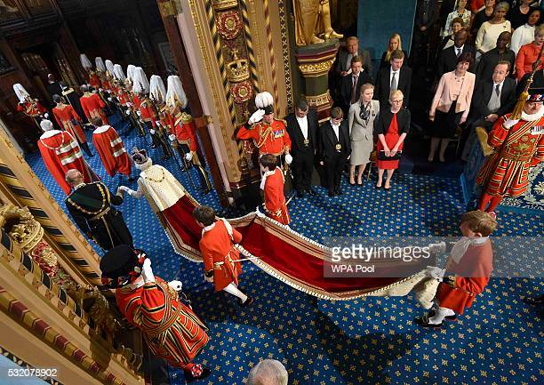 Prince Philip Duke of Edinburgh holds the hand of Queen Elizabeth II as she proceeds through the Royal Gallery before the State Opening of Parliament...