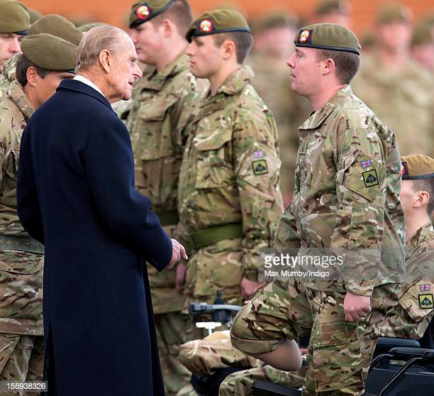 Prince Philip, Duke of Edinburgh, in his role as Colonel of the Grenadier Guards, talks with injured soldier Guardsman Chris Waller as he presents...