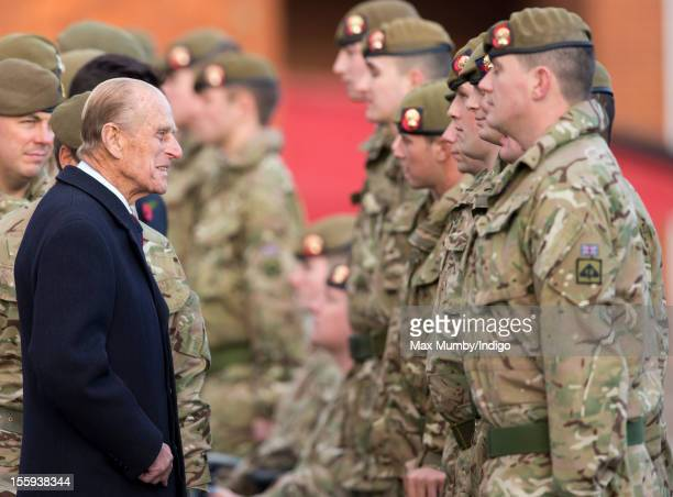 Prince Philip, Duke of Edinburgh, in his role as Colonel of the Grenadier Guards, presents Afghanistan Operational Service Medals to 30 wounded...
