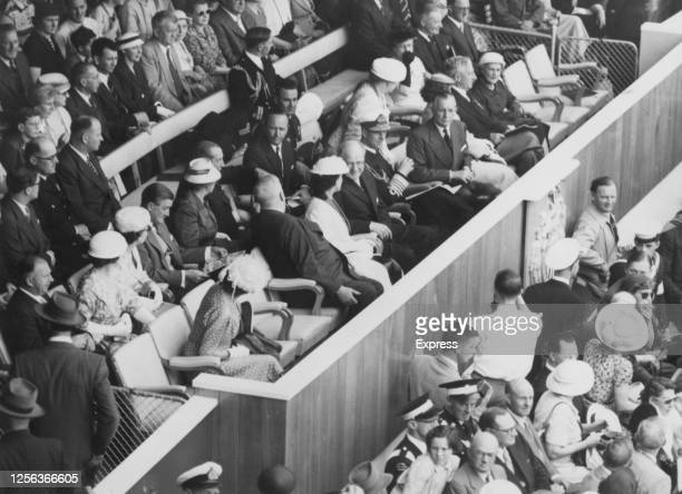 Prince Philip, Duke of Edinburgh, in naval uniform, among the dignitaries watching the parade of athletes at the opening ceremony of the 1956 Summer...