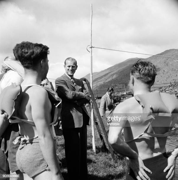 Prince Philip Duke of Edinburgh in North Wales A smile from the Duke to these canoeists who were about to exercise on Lly Mymbyr the lake near the...