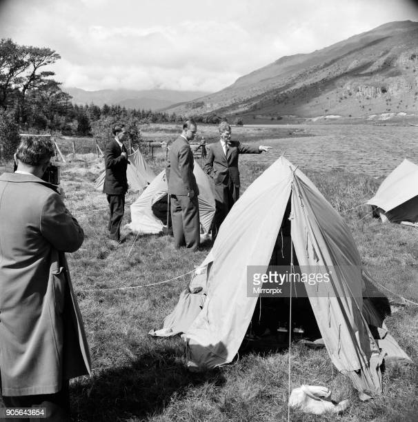 Prince Philip Duke of Edinburgh in North Wales Sir John Hunt points while the Duke's attentions is attracted by a waterproof tent This was at the...