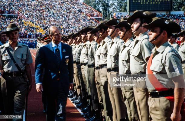 Prince Philip Duke of Edinburgh inspects an Australian army guard of honour as he opens the Commonwealth Games in Brisbane Australia on September 30...