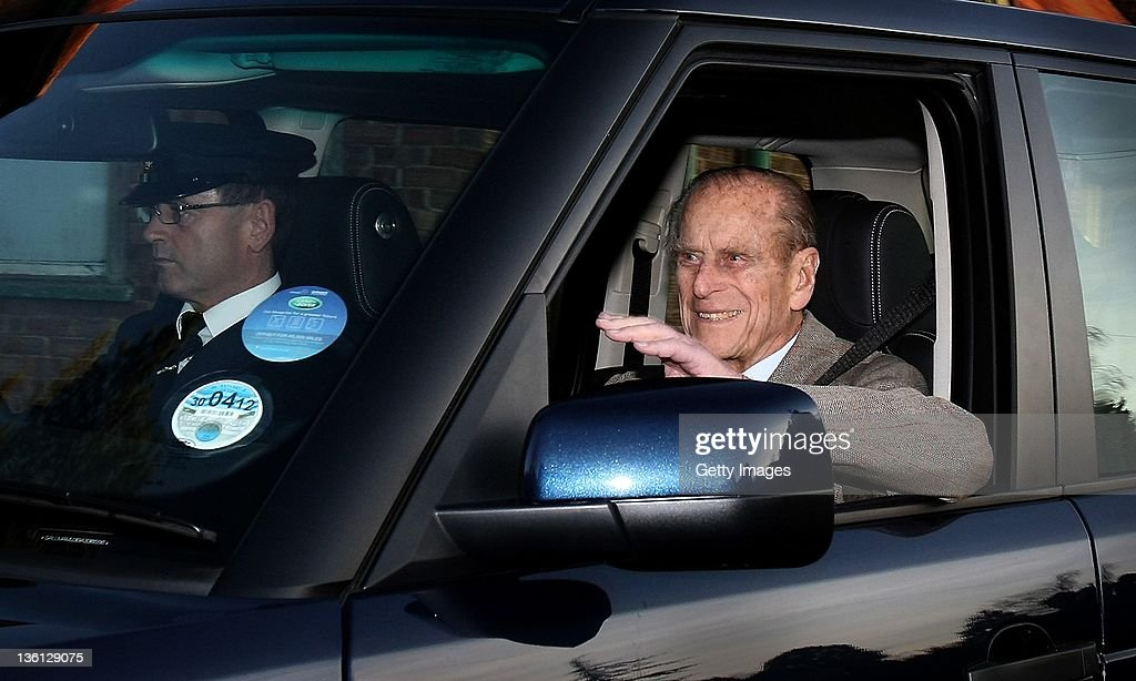 Prince Philip, Duke of Edinburgh (R), is driven from Papworth Hospital on December 27, 2011 in Cambridge, Cambridgeshire. The Duke is returning to the Sandringham Estate to join other members of the Royal Family for Christmas after receiving treatment for a blocked artery.