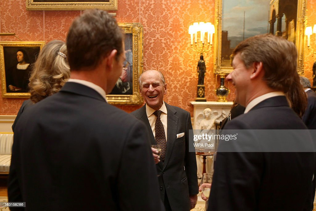 Prince Philip, Duke Of Edinburgh (C) laughs during a reception for MPs and MEPs at Buckingham Palace on March 5, 2013 in London, England. The reception was attended by Prince Philip, Duke Of Edinburgh, and Sophie, Countess of Wessex.