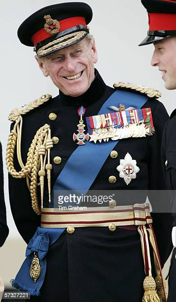 Prince Philip, Duke of Edinburgh laughs with his grandson Prince William at the Sovereign's Parade at Sandhurst Military Academy on April 12, 2006 in...
