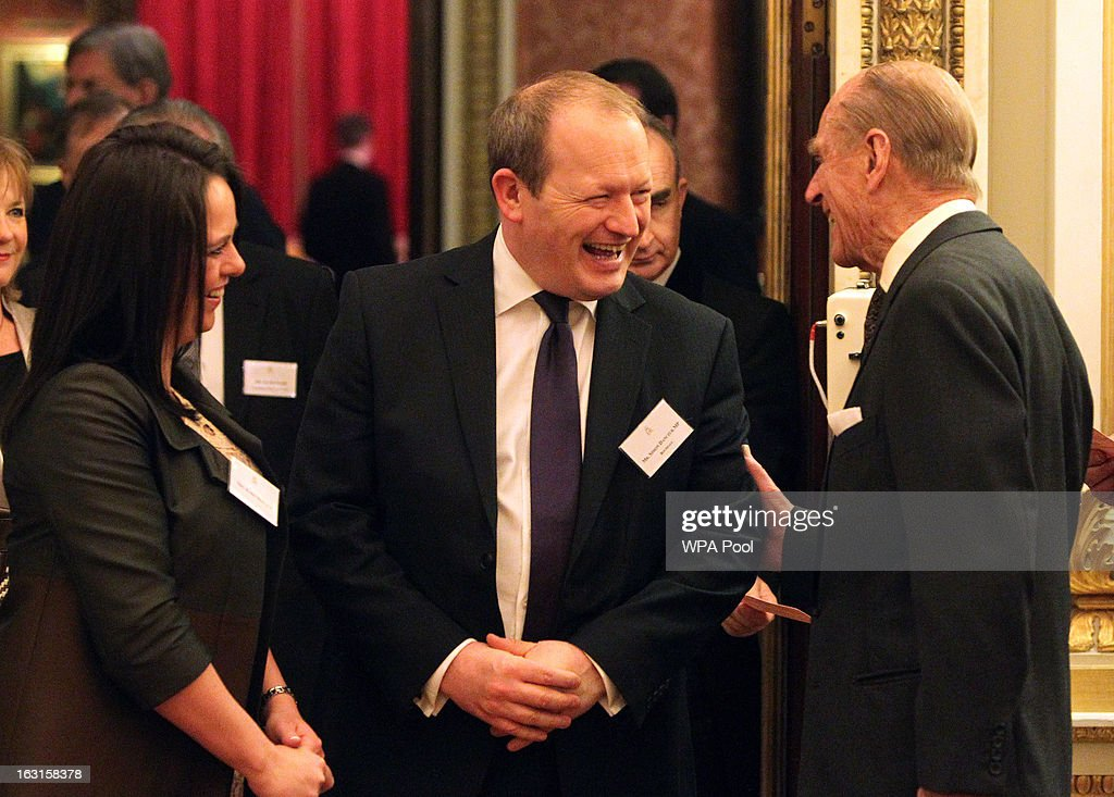 Prince Philip, Duke Of Edinburgh (R) laughs with Simon Danczuk MP for Rochdale (C), during a reception for MPs and MEPs at Buckingham Palace on March 5, 2013 in London, England. The reception was attended by Prince Philip, Duke Of Edinburgh and Sophie, Countess of Wessex.