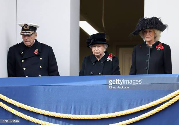 Prince Philip Duke of Edinburgh leans against the wall as Queen Elizabeth II and Camilla Duchess of Cornwall watch over the annual Remembrance Sunday...