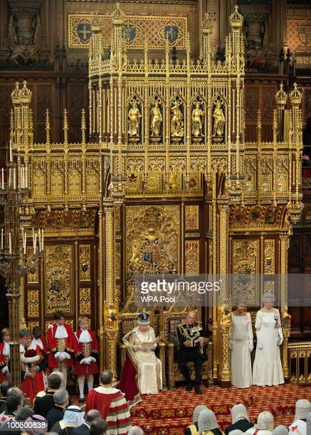 Prince Philip Duke of Edinburgh listens as his wife Britain's Queen Elizabeth II speaks as she addresses the House of Lords during the State Opening...