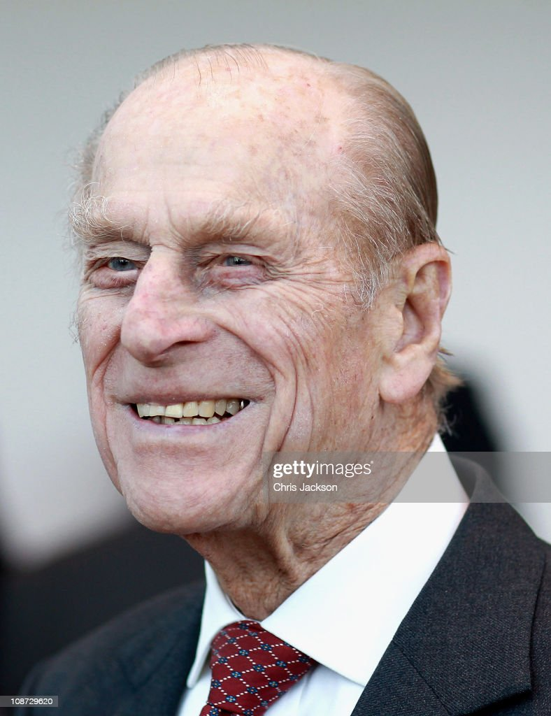 Prince Philip, Duke of Edinburgh looks on as he meets employees during a visit to Palm Paper on February 2, 2011 in Norwich, England. The Queen and Duke of Edinburgh are visiting sites today, which include the Palm Paper mill and West Norfolk Deaf Association in King's Lynn.